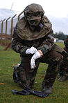 2nd Lt. Noel Horton of the 48th Communications Squadron, 48th Fighter Wing RAF Lakenheath United Kingdom gets into MOPP 4 gear during a Chemical Warfare Training Class on Wednesday the 15th of November 2006 061115-F-ZM185-003.jpg