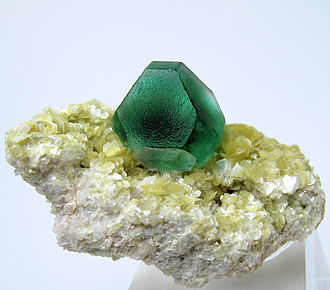 Fluorite - Deep green isolated fluorite crystal showing cubic and octahedral faces, set upon a micaceous matrix, from Erongo Mountain, Erongo Region, Namibia (overall size: 50 mm x 27 mm, crystal size: 19 mm wide, 30 g)
