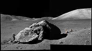 Taurus–Littrow - Astronaut Harrison Schmitt is seen next to a large boulder in the Taurus–Littrow valley on the Apollo 17 mission in 1972. The South massif is visible to the right.