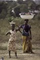 ASC Leiden - F. van der Kraaij Collection - 01 - 078 - A young girl and a woman carrying enamel bowls with freshly washed clothes - Voinjama, Lofa County, Liberia, 1976.tiff