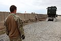 A British soldier, left, with Combat Support Logistics Regiment 12 ground-guides a U.S. Marine with Transportation Support Company, Combat Logistics Regiment 2 while offloading a heavy equipment vehicle after 130225-M-KS710-164.jpg