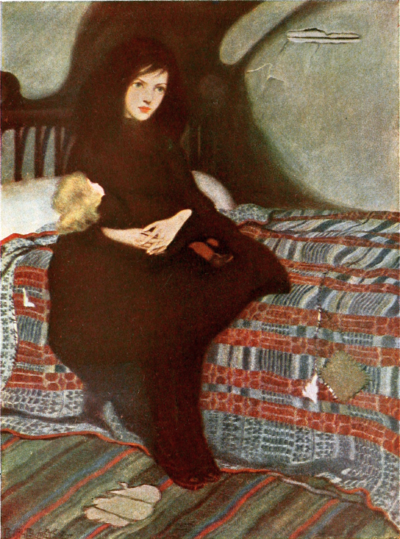a girl sitting on a bed with a doll on her lap