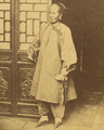 A Nanny or Servant from a Rich Household, in a Cotton Gown over Trousers, with Traditional Lotus (Bound) Feet. China, 1874 WDL1918 (cropped).png