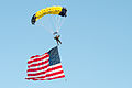 A U.S. Sailor with the Leap Frogs parachutes onto the field at Notre Dame Stadium in South Bend, Ind., Sept. 6, 2014, before a football game 140906-D-KC128-152.jpg