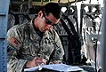 A U.S. Soldier serving as a UH-60 Black Hawk helicopter pilot with the 1st Battalion, 169th Aviation Regiment completes aircrew paperwork after flying an aerial reconnaissance mission at Camp Atterbury, Ind 120802-F-UI476-066.jpg