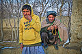 A local Afghan man and boy watch as U.S. Soldiers serving with Outlaw Platoon, 164th Military Police Company, Task Force Maverick, and the Afghan National Army, patrol their village in Parwan province 120111-A-LP603-134.jpg