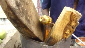 File:A maize dish making by roadside vendor.ogv