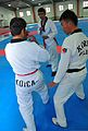 Afghan National Police (ANP) students learn taekwondo from a South Korean national police taekwondo master at the ANP Training Center supported by the South Korea Provincial Reconstruction Team for Parwan 120127-N-VN372-037.jpg