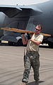 Air Transportation Airmen From the 380th Expeditionary Logistics Readiness Squadron's Air Terminal Operations Center Drives a 60,000-pound-capable Aircraft Loader to Unload a Plane During Operations DVIDS290891.jpg