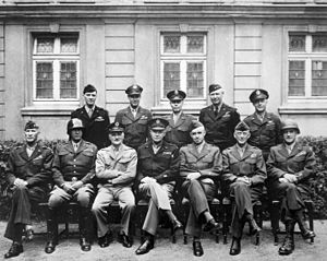 Leonard T. Gerow - Senior American commanders in Western Europe, 1945. Seated are, from left to right, William Hood Simpson, George S. Patton, Carl A. Spaatz, Dwight D. Eisenhower, Omar Bradley, Courtney Hodges, Leonard T. Gerow. Standing are, from left to right, Ralph Francis Stearley, Hoyt Vandenberg, Walter Bedell Smith, Otto P. Weyland, and Richard E. Nugent.