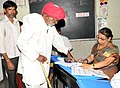 An old man voter registering his name to cast his vote, at a polling booth during the 5th Phase of General Elections-2014, at Shirdi, Maharashtra on April 17, 2014.jpg