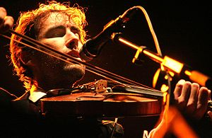 Andrew Bird with violin in concert Category:An...