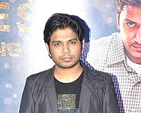 Ankit Tiwari is looking at the camera