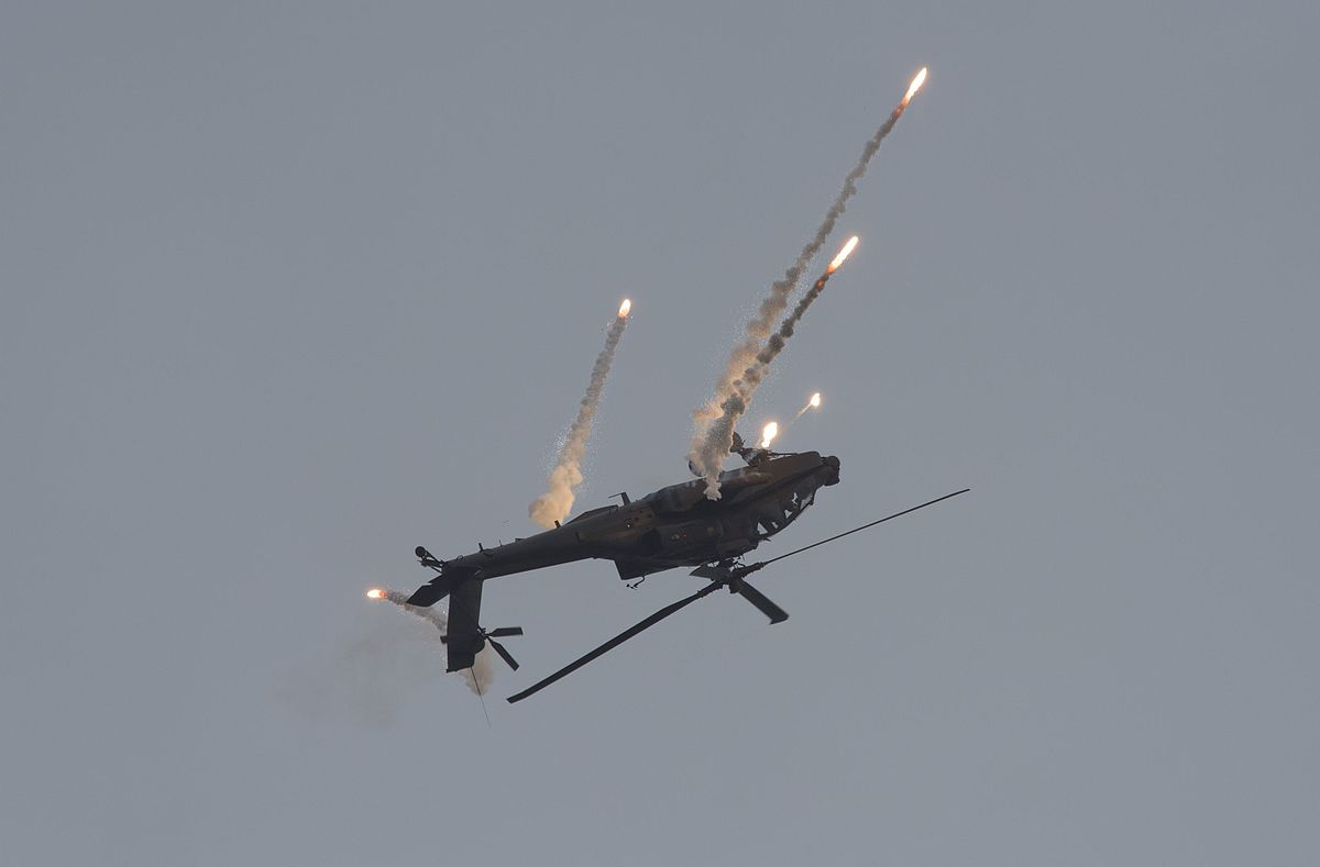 1200px Apache helicopter shoots off decoy flares Leeuwarden Air Base 2016