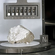 A white rock, placed in a laboratory setting