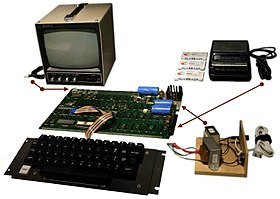 Apple I system board with TV set, cassette recorder, power supply unit and keyboard