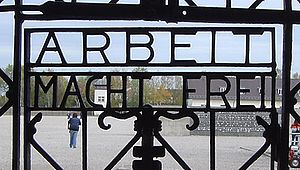 Extermination through labour - Gate in the Dachau concentration camp memorial.