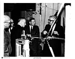 Armstrong looks at test apparatus with others (2).jpg