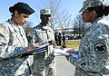 Army Reserve Master Sgt. Libby Lipscomb, Master Sgt. (Ret.) Thomas Montgomery, and Army Reserve Master Sgt. Carla Sanders, discuss scoring.jpg