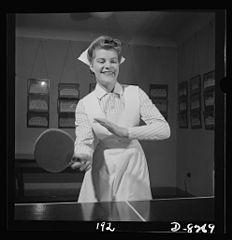 At the ping pong table in the game room, Susan Petty, student nurse 8b07884v.jpg