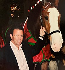 August A. Busch IV with Budweiser Clydesdale.jpg