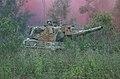 Australian Leopard AS1 tank forest smoke.jpg