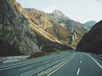 Rruga e Kombit connects the Adriatic Sea across the Western Lowlands with the Albanian Alps in the north reaching the border with Kosovo. Autostrada Durres-Morina-05.jpg