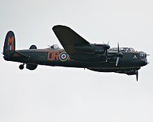 Colour photograph of a Lancaster Bomber in flight