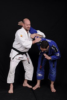 3rd degree black belt professor in brazilian Jiujitsu illustrates the transition to Ude hishigi ude gatame