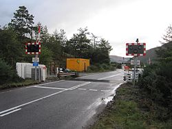 Balnacra Level Crossing - with new barriers (10422420954).jpg