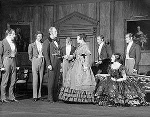 Joyce Carey - Joyce Carey (seated right) as Arabella Barrett in the original Broadway production of The Barretts of Wimpole Street (1931)