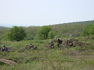 Infantry tactics - A Romanian squad of a TAB-77 APC. This is a typical Soviet arrangement, with a PK general purpose machine gun and a RPK light machine gun in the center and two soldiers with AK-47 assault rifles and one RPG-7 grenade launcher on the flanks. Another soldier provides liaison or extra firepower where needed.
