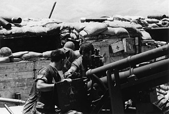 Firebase Fuller - Battery A, 1/12 Marines prepare to fire their 105mm gun in 1969