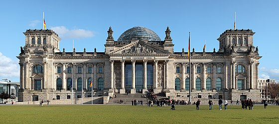 German unity was established on 3 October 1990. Since 1999, the Reichstag building in Berlin has been the meeting place of the Bundestag, the German parliament. Berlin reichstag west panorama 2.jpg