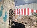 Bethlehem wall graffiti by Swoon and Ron English.jpeg