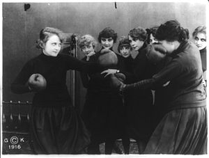 Gloria's Romance - Film still of Billie Burke boxing with woman in a gymnasium.