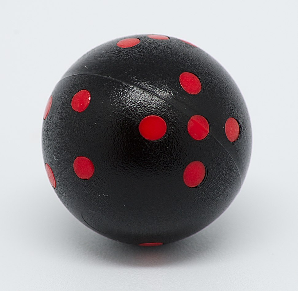 Black and red round 6-sided die