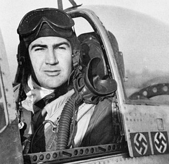 Robert V. Whitlow - Whitlow in his P-51 which bears markings from his two aerial kills on November 26, 1944
