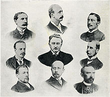 A late 19th-century lithograph showing the heads and shoulders of nine gentlemen in three rows. The man in the centre appears to have been deliberately made more prominent than the others, appearing larger and more strongly drawn.