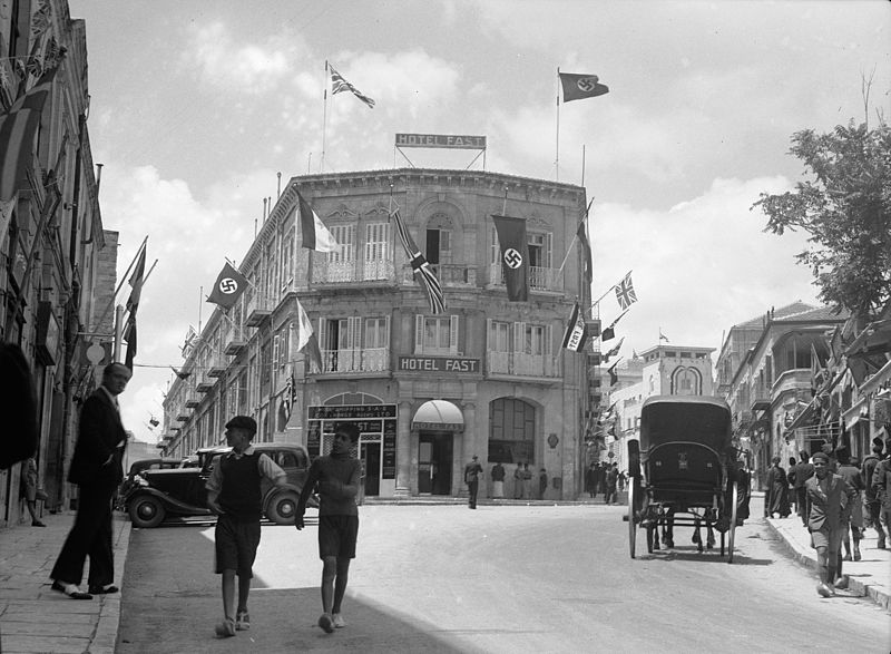File:British and Nazi flags flying from the Fast Hotel. matpc.16994.jpg