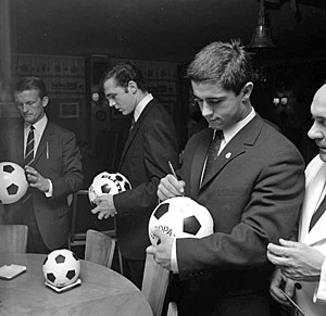 Gerd Müller - Müller autographing a football in 1967. To his right are Franz Beckenbauer and Werner Olk.