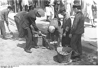 Białystok Ghetto - Local Jews forced by the Nazis to sweep streets, June 1941