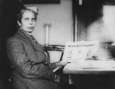 Blackwell holding a copy of Woman's Journal, around 1910.
