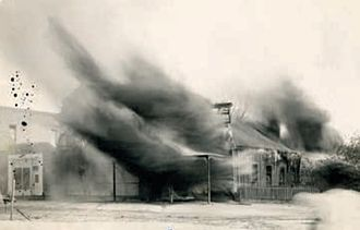 C. S. Fly - An image of the photography studio of C. S. and Mollie Fly burning in 1912, taken by Mollie Fly.