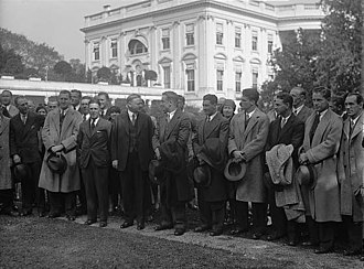 Nibs Price - Cal 1929 football team invited to the White House, during their October trip to play at Penn. Coach Price and President Hoover are in the center looking at each.