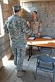 Capt. John Arthur receives a briefing (7650841324).jpg
