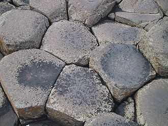 Large masses must cool slowly to form a polygonal joint pattern, as here at the Giant's Causeway in Northern Ireland Causeway23.jpg
