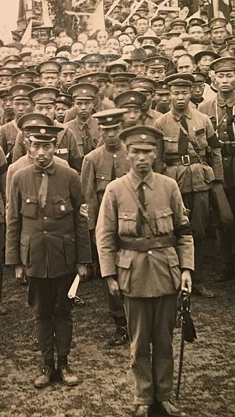 Zhou Enlai - Chiang Kai-shek (center) and Zhou Enlai (left) with cadets at Whampoa Military Academy (1924)