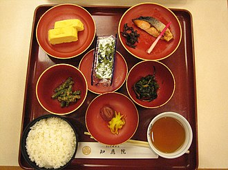 Breakfast - A traditional Japanese breakfast for a tourist at Buddhist temple Chion-in. Rice, Japanese pickles (umeboshi and takuan), a slice of grilled salmon, egg, nori, some vegetable; perhaps a kind of いんげん  (Phaseolus vulgaris) with sesame powder