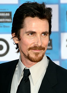 Headshot of Christian Bale looking to the right of the camera